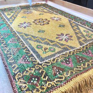 Carpet made with 26,649 precious stones and 15.90 kilograms of 18k gold.